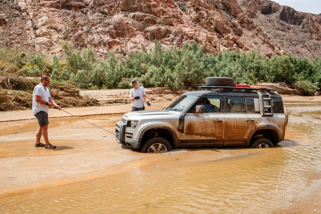 Driving the 2020 Land Rover Defender proves it's ready to conquer the world again_wading in a river_Hagerty_winching out of a river