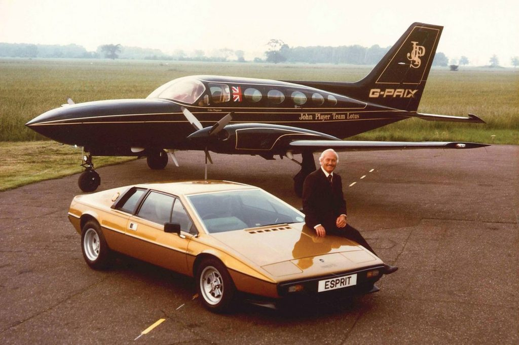 Colin Chapman with JPS plane and Lotus Esprit