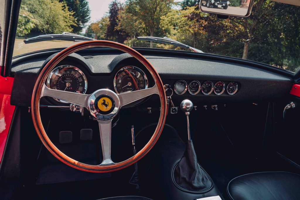 The dashboard of the Ferrari 250 GT SWB recreation is a work of art