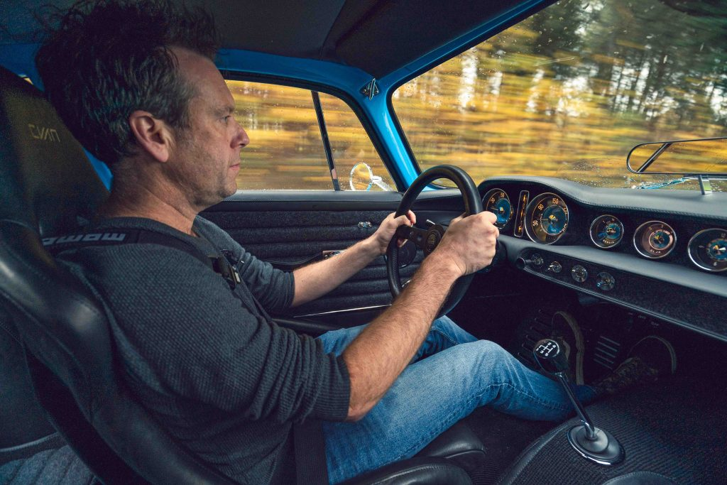 Ben Barry driving the Volvo P1800 Cyan for Hagerty