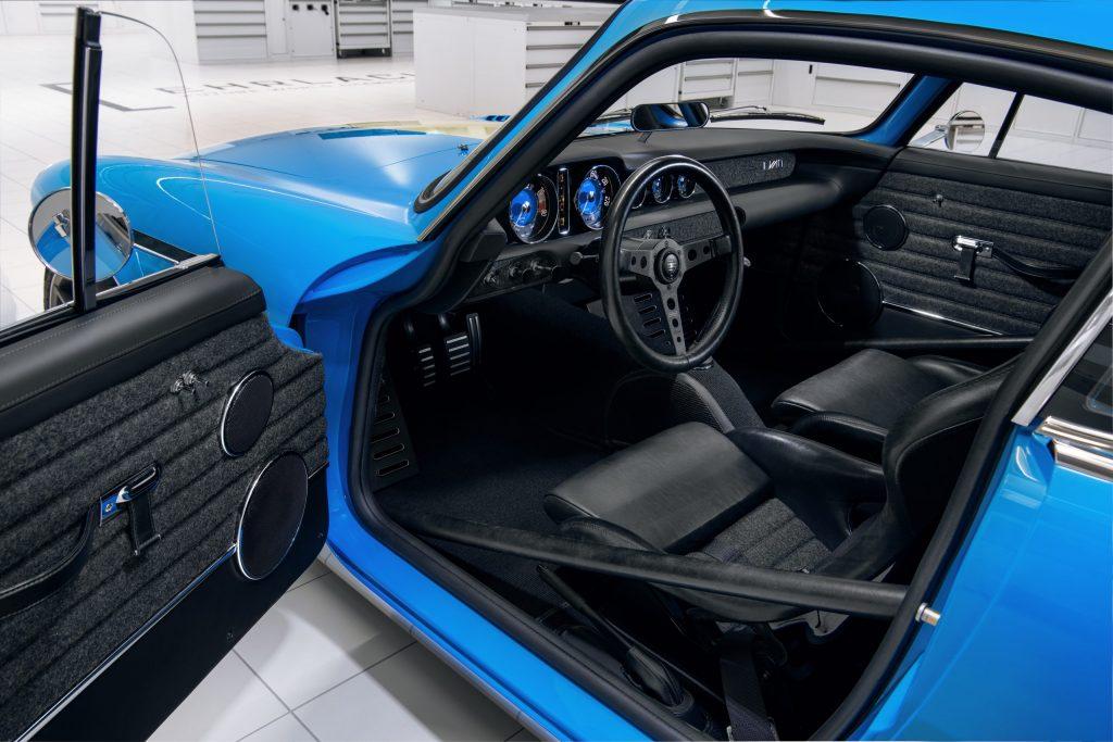Momo seats and steering wheel in the Volvo P1800 Cyan restomod