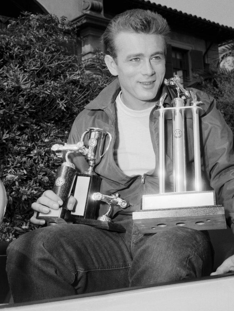 James_Dean_Holding_Racing_Trophies
