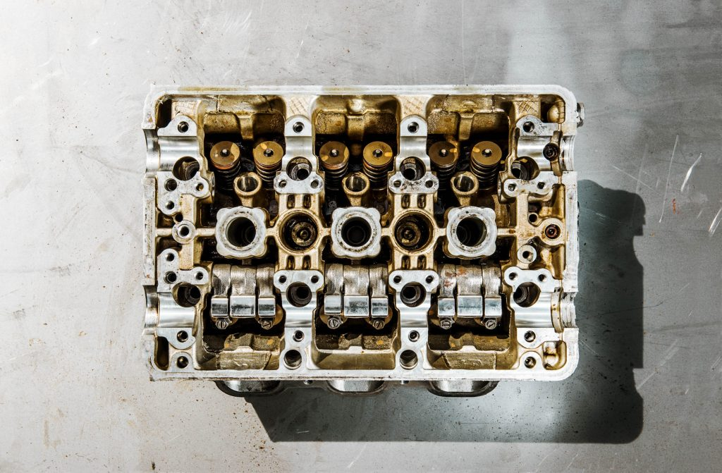 Removing the camshafts from this 1991 Acura NSX VTEC V-6 reveals the valves at the top and the three rocker arms per valve pair at the bottom. Photo: Josh Scott
