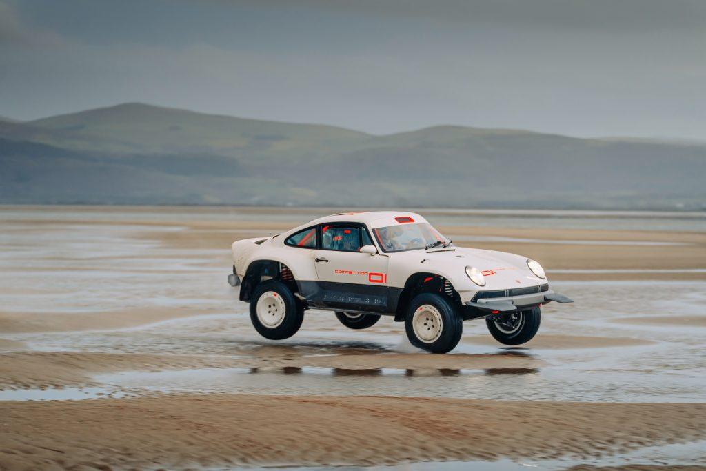 Porsche 911 Singer ACS jumping sand dunes