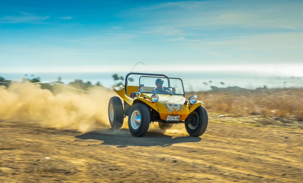 Fun on the beach in a Meyers Manx dune buggy