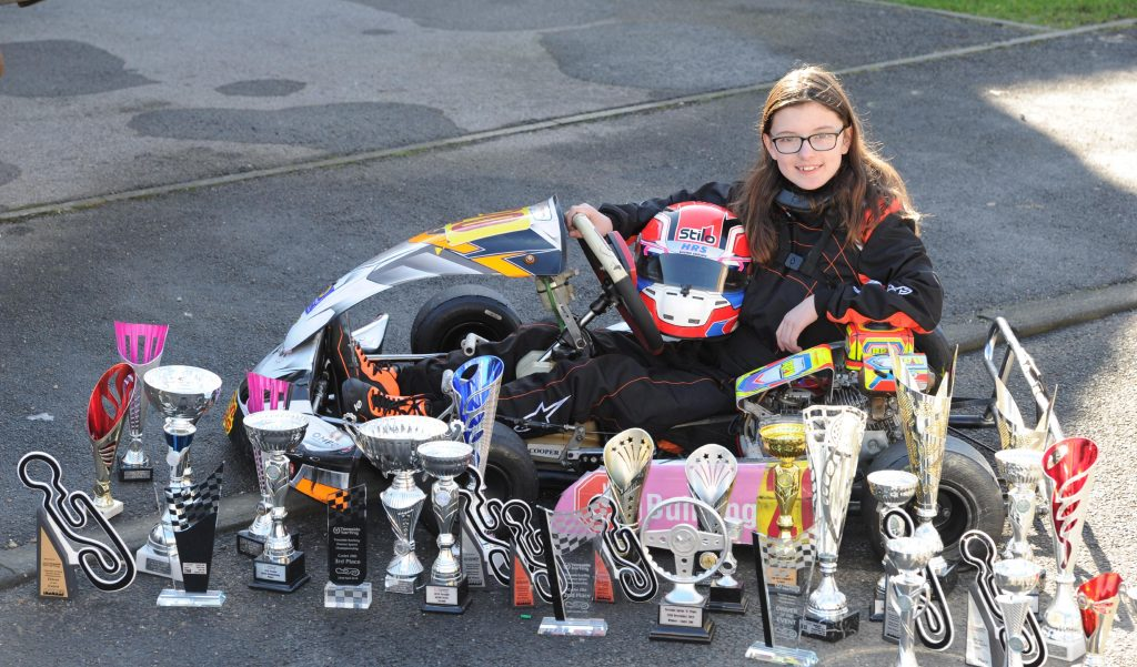Catherine Potter with karting trophies