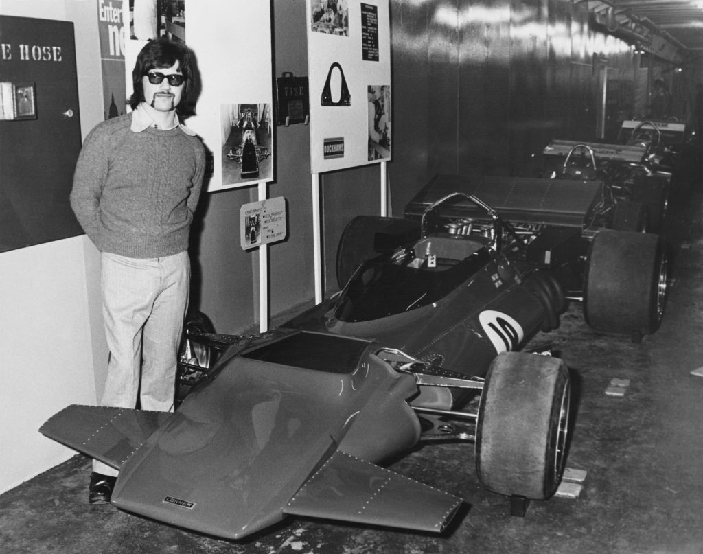 Peter Connew stands beside his own designed and garage built Connew Racing Team Connew PC1 Ford V8 Formula One Grand Prix car at the Evening News Motor Racing Show held aboard the Townsend Thoresen car ferry Free Enterprise II on 31 December 1971 at London, United Kingdom. (Photo by Jimmy Wilds/ Keystone/ Hulton Archive/Getty Images).