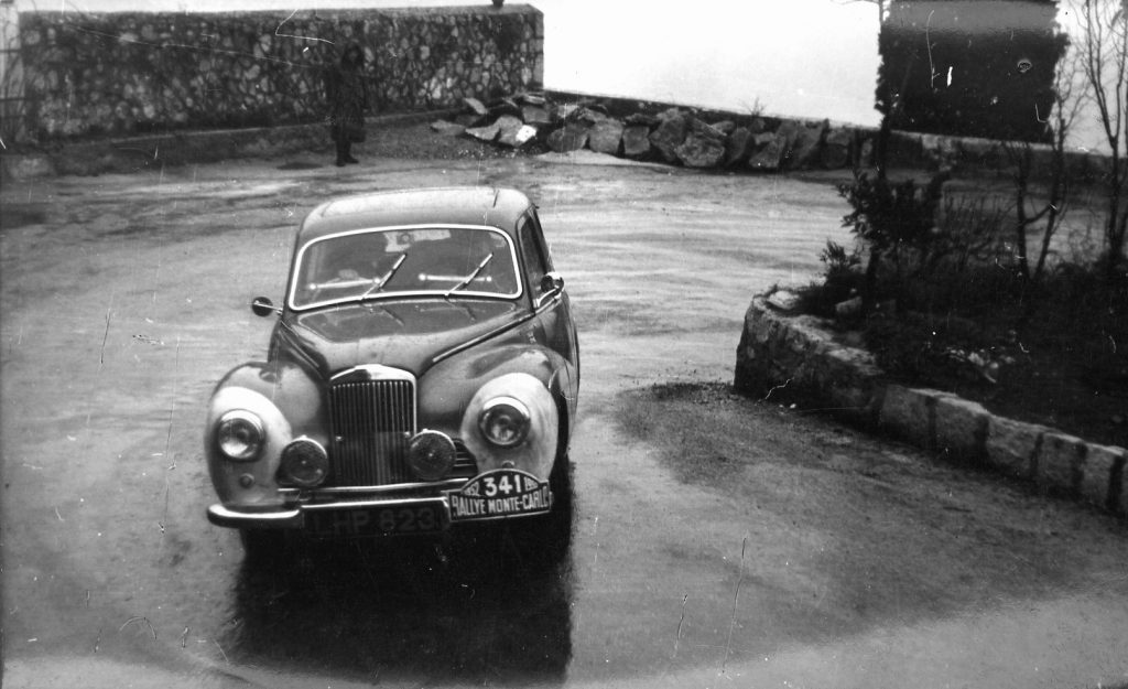 The Moss/Scannell/Cooper Sunbeam Talbot starts the climb into the mountains at the start of the last stages of the Monte Carlo Rally 1952. Note the white-washed front wings to identify the competing cars for the benefit of the marshals