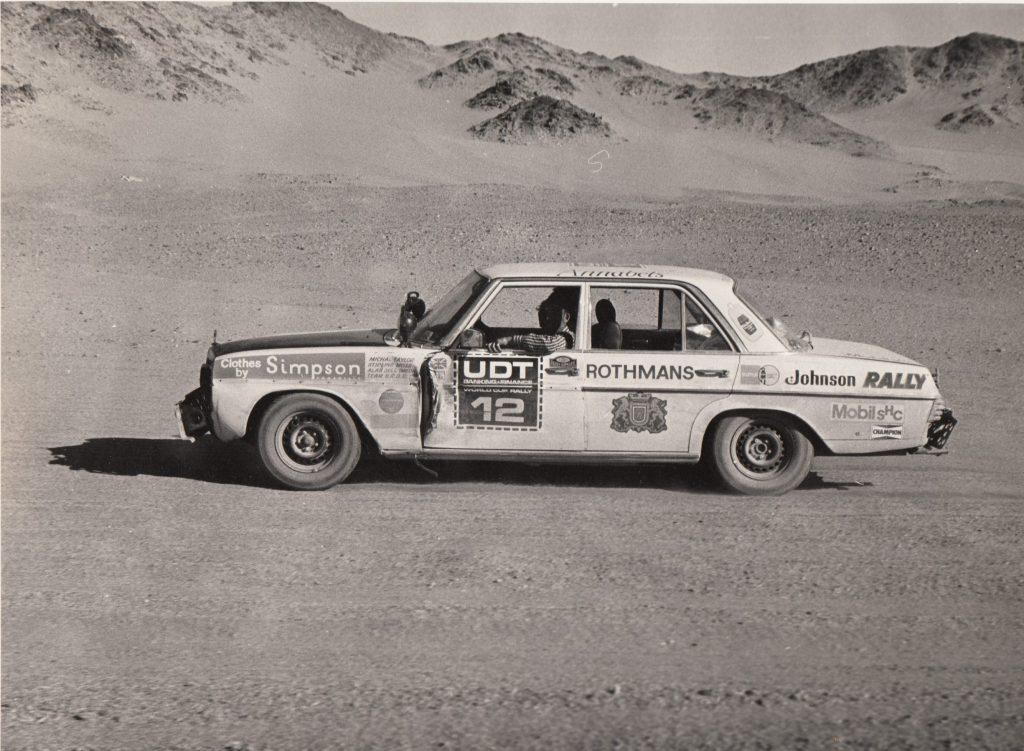 A second-hand looking Mercedes Benz of Moss/Taylor/Sell in the Sahara Desert after the team had been rescued. Sell was in one fop the Land Rovers recovering.