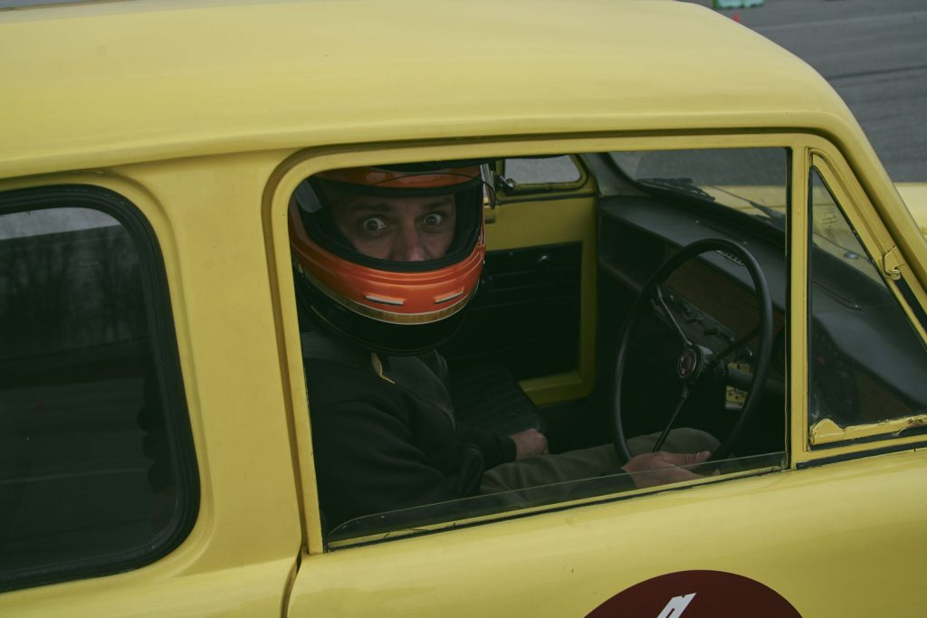 Sam Smith at the wheel of a Reliant Regal