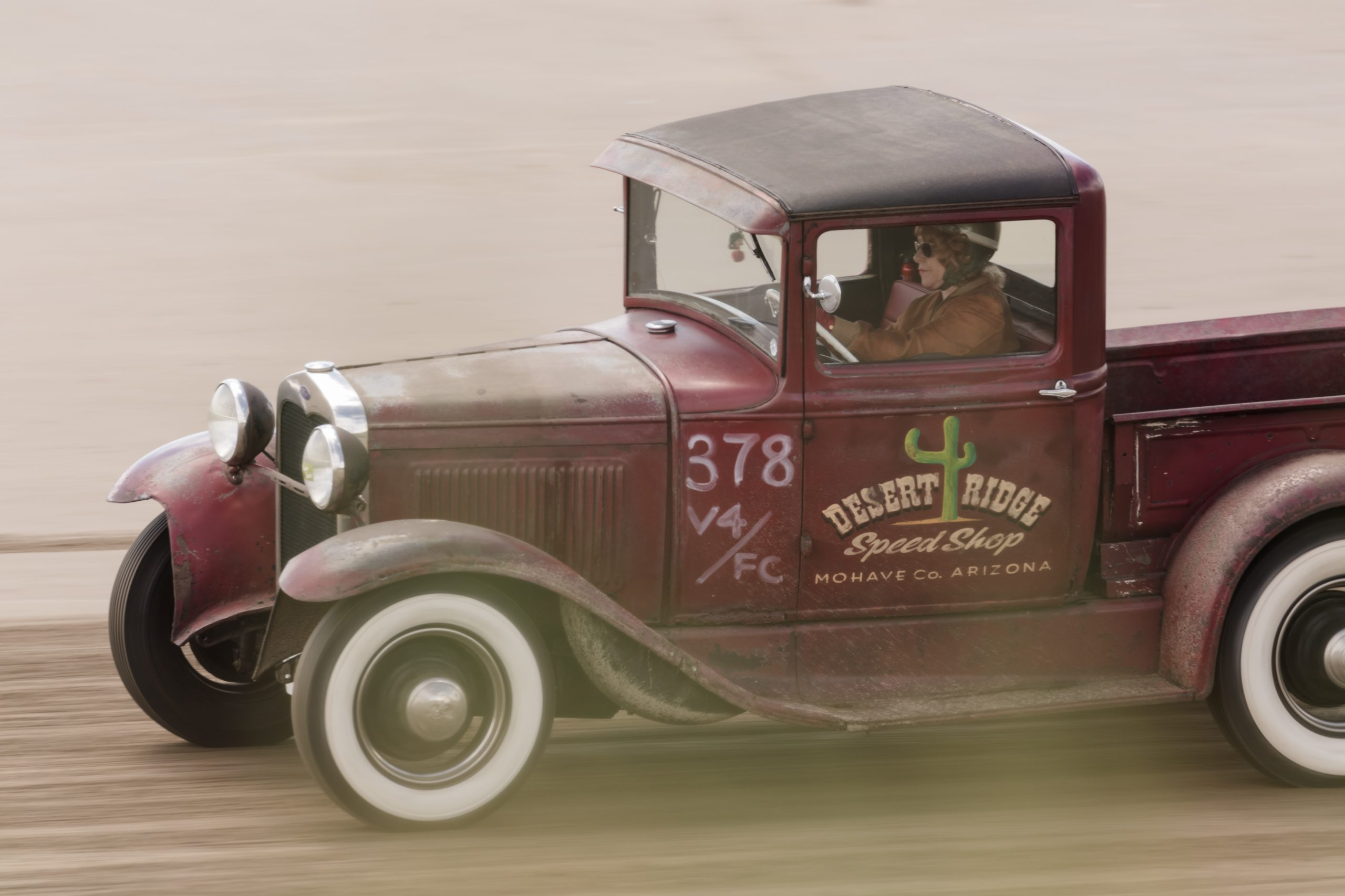 Lisa Coombes driving her hot rod at Pendine Sands
