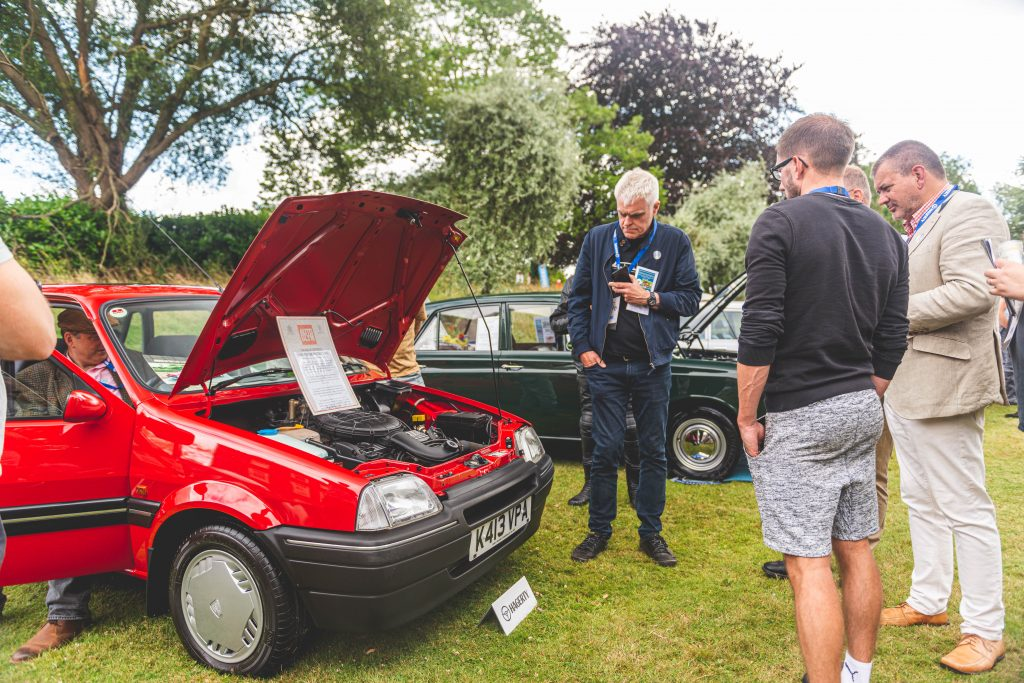 Jon Bentley judges a Rover 100 at the Hagerty Festival of the Unexceptional 2019