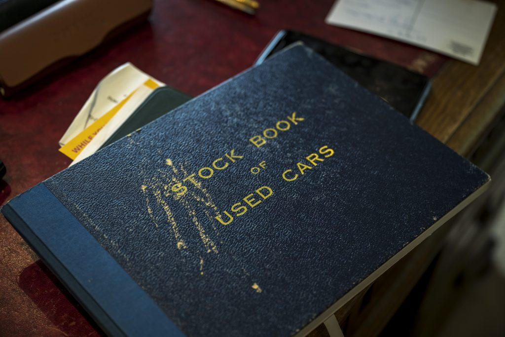 Michael Fisher's stock and used car inventory book