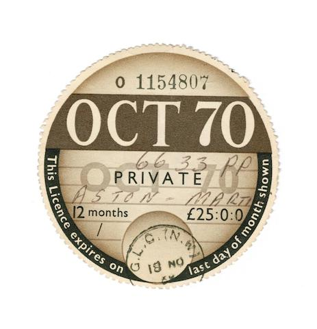 Who paid £25,000 for a paper tax disc from the James Bond Aston Martin DB5?